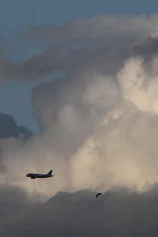 Jet plane against clouds (Photo: Tim Jones)
