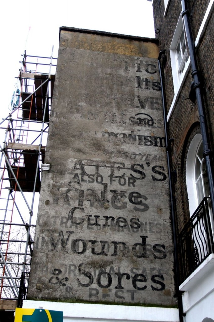 Old advertisements on a wall, corner of Regent's Square / Sidmouth Street, London (Photo:Tim Jones)