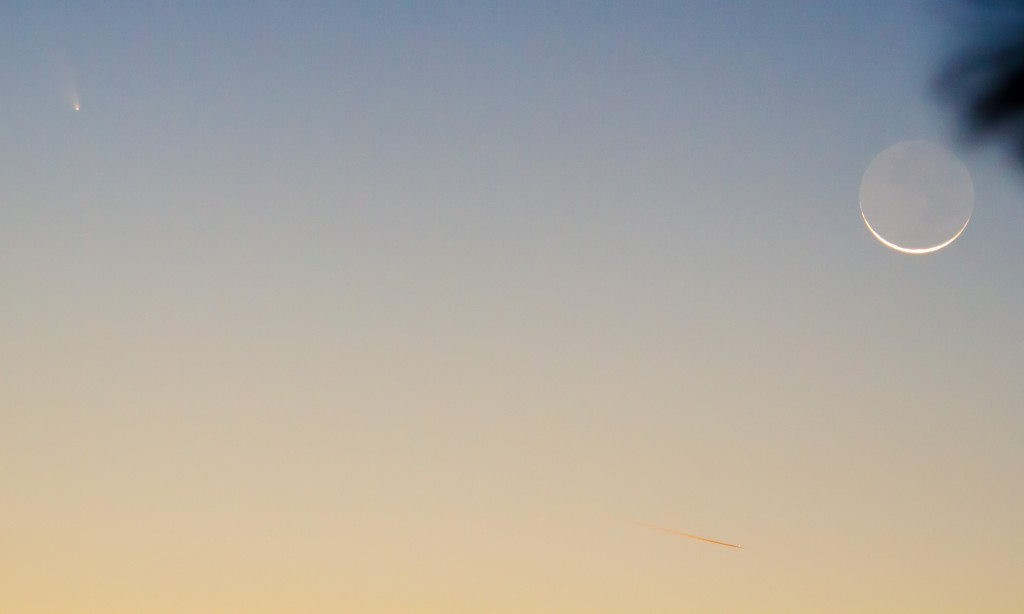 Comet, Moon, and aircraft with contrail illuminated by sun (below horizon)